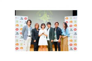 The winner of Anisong stars, 17-year-old Akane Kumada, with the judges.
