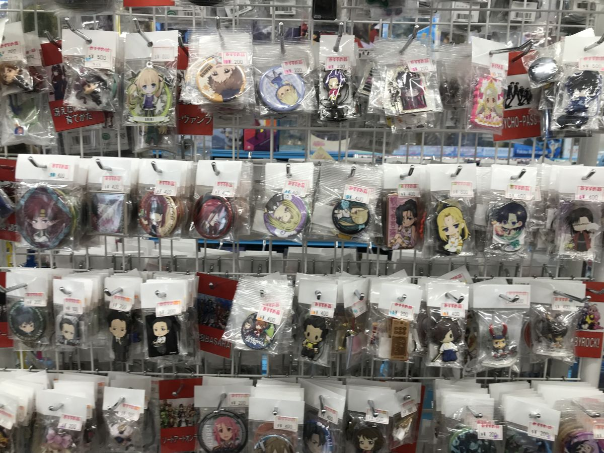 wall of badges keychains and misc items